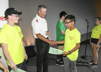 Honeywell's Stephen Miller congratulates each student at the recognition ceremony.