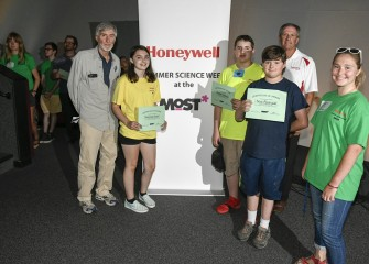 Members of Team Blue display their recognition certificates for completion of Honeywell Summer Science Week.